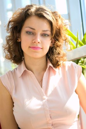 chemise: portrait of smiley woman in pink chemise