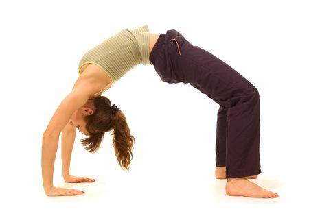 sportswoman making bridge on white background photo