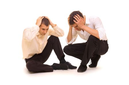 offence: two sad businessmen sitting on the floor. isolated on white Stock Photo