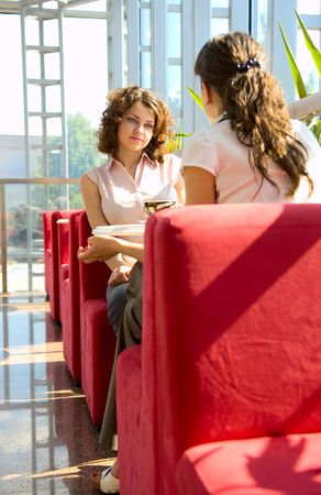 two women sitting in cafe and have a nice conversation Stock Photo
