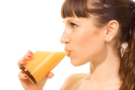 attractive woman drinking orange juice. isolated on white photo
