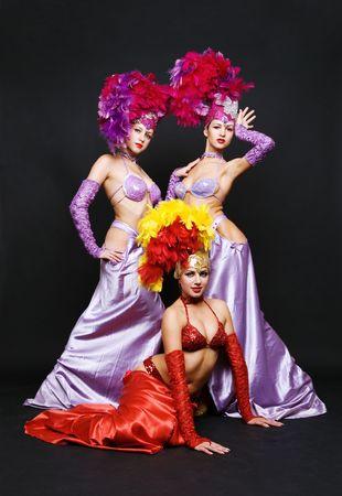 gogo girl: sch�ne Trio vor einem dunklen Hintergrund Lizenzfreie Bilder