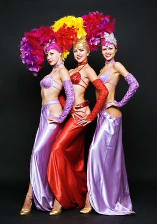 trio: beautiful trio in stage costumes over dark background