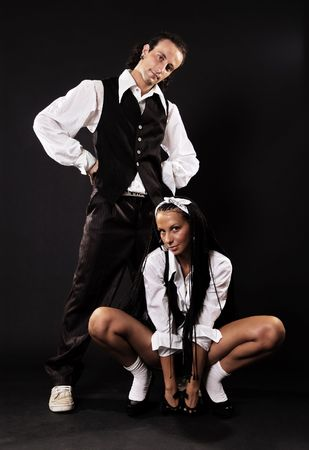 long socks: man and woman over dark background