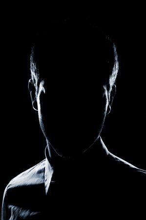 incognito: silhouette of man over dark background