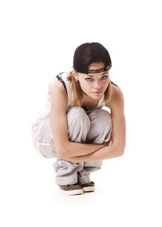 roughneck: slim hip hop girl sitting on the floor. isolated on white Stock Photo