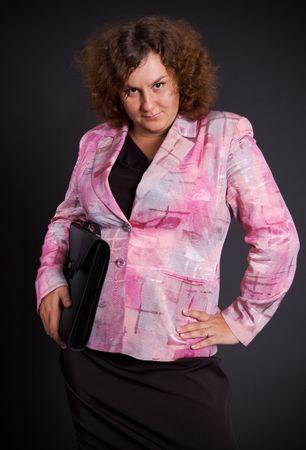 elegant heavy businesswoman over dark background photo