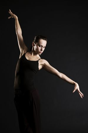 beautiful ballerina posing over dark background Stock Photo - 3578001
