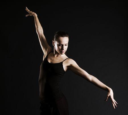 graceful ballerina against dark background photo