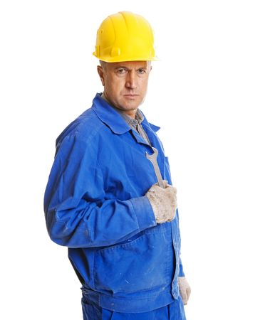 screw key: serious worker with screw key. isolated on white