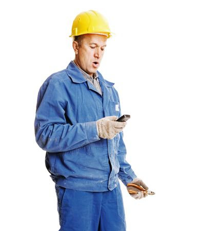 surprised workman reading message. isolated on white photo