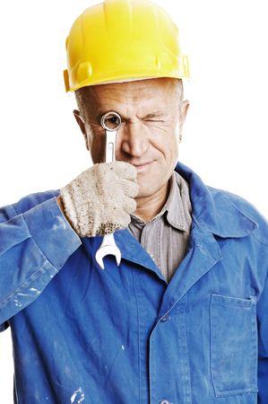 screw key: smiley worker looking through screw key