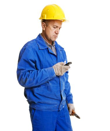 worker reading message in his mobile phone. isolated on white photo