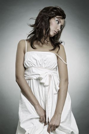 beautiful sad woman in white dress Stock Photo - 3611937