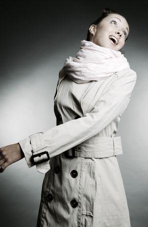 beautiful model in grey cloak over grey background photo