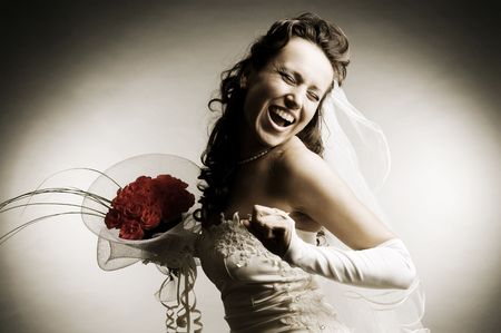 sepia toned image of happy bride with bunch of roses photo