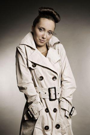 beautiful woman in grey cloak photo