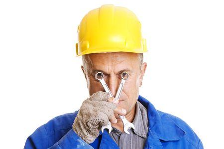 workman looking through screw keys. isolated on white photo