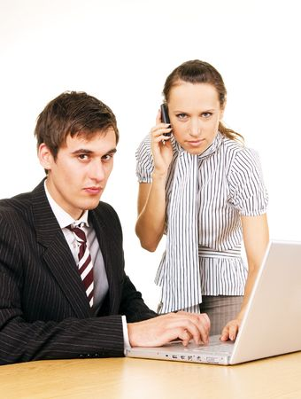 young businessman with laptop and secretary with phone over white background photo