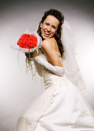 laughing bride with bouquet of roses photo