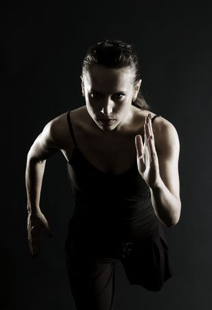attractive athlete running over black background Stock Photo - 3663947