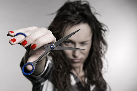 attractive hairdresser with scissors over grey background Stock Photo - 3704574