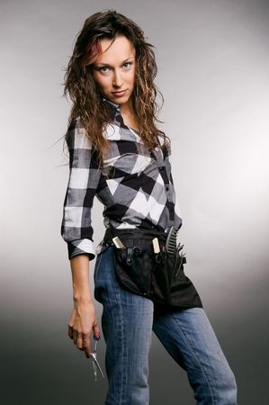 attractive hairdresser with scissors in her hand. studio shot over grey background Stock Photo - 3704611