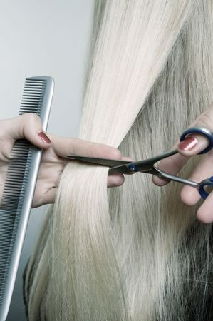 hairdressing scissors: closeup of haircut. studio shot Stock Photo