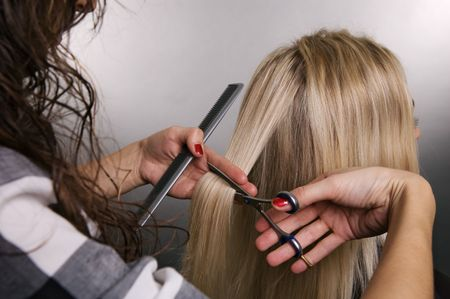 hairdresser at work over grey background Stock Photo