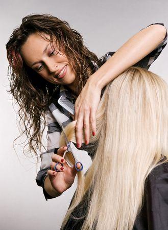 hairdresser in work. studio shot over grey background Stock Photo - 3704633