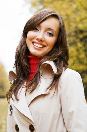smiley woman in the park in autumn photo