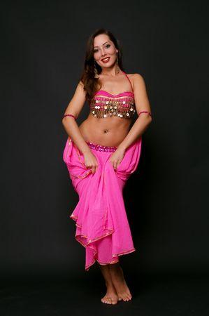 beautiful dancer in oriental costume over black