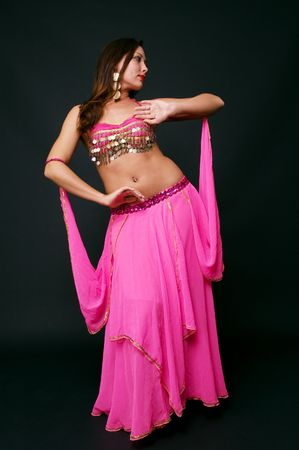 beautiful belly dancer in action. studio shot over black Stock Photo - 3760266