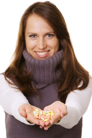happy woman with pills in hands over white photo
