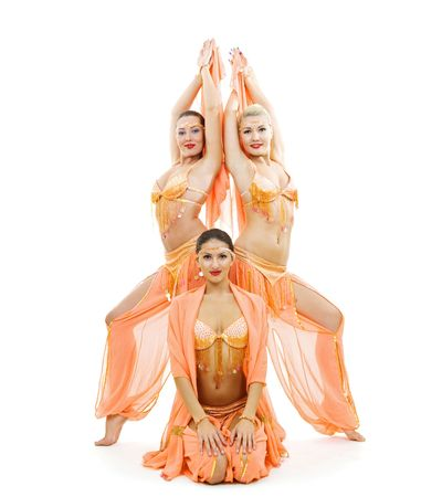 three dancers in bright arabian stage costumes. isolated on white photo