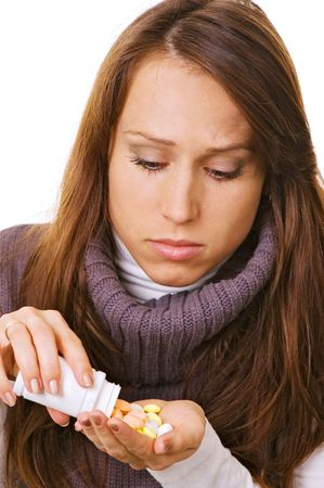young woman with bottle of pills over white Stock Photo - 3774927