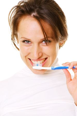 smiley young woman cleaning her teeth over white background photo
