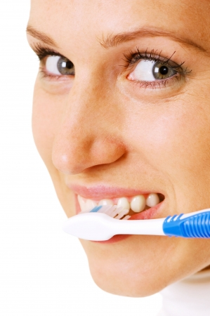 young woman cleaning her teeth at the morning photo