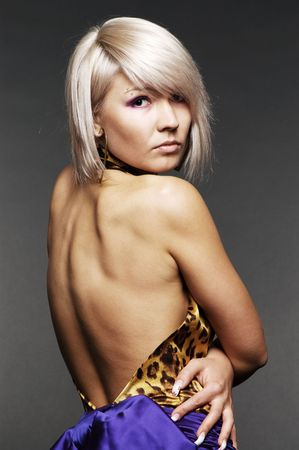 glamour model with naked back against grey background Stock Photo