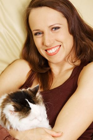 smiley woman with her pet on the sofa photo