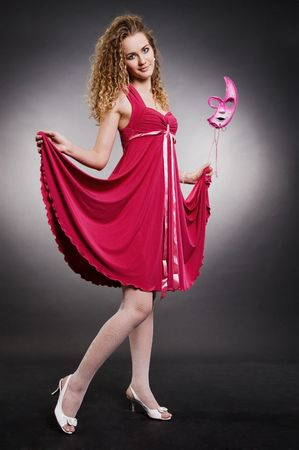 beautiful woman in pink dress with mask photo