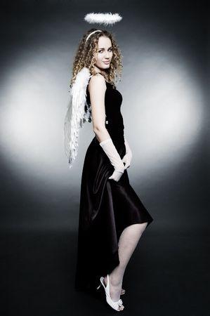 coquette angel over dark background photo