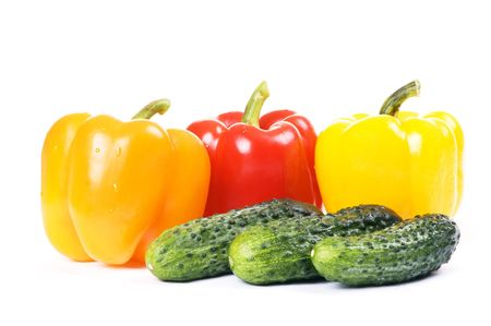 cucubmers and paprika isolated on white background Stock Photo - 4022333
