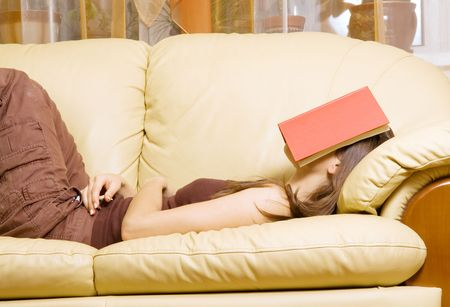 woman sleeping with book on her face photo