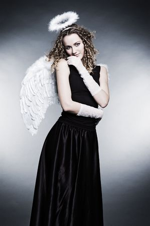 dramatic picture of young curly angel photo