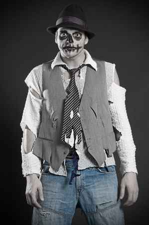 deadman: pallid deadman in rags  against dark background