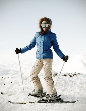 portrait of attractive skier on the snow