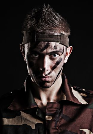 portrait of serious soldier over black background Stock Photo - 4175054