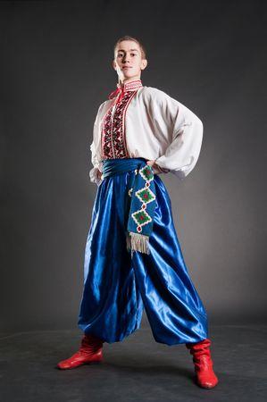 young ukrainian cossack over dark background photo
