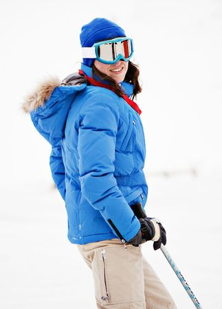 portrait of young woman on ski resort photo
